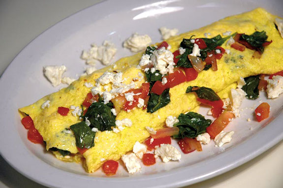 Two omeletes with spinach & feta cheese with diced tomato