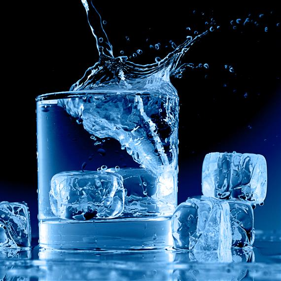 cubes of ice being dropped into a glass