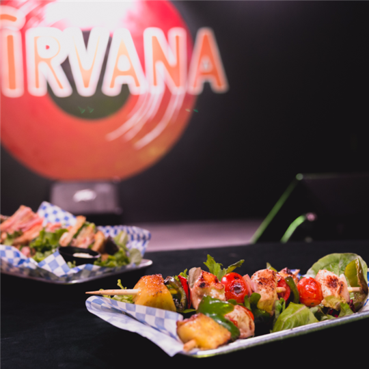 appetizers with the nirvana sign in the background