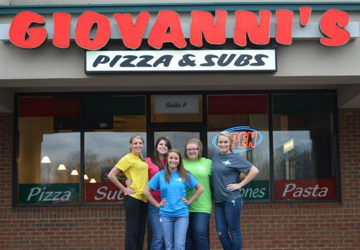 employees out front of giovanni's pizza and subs