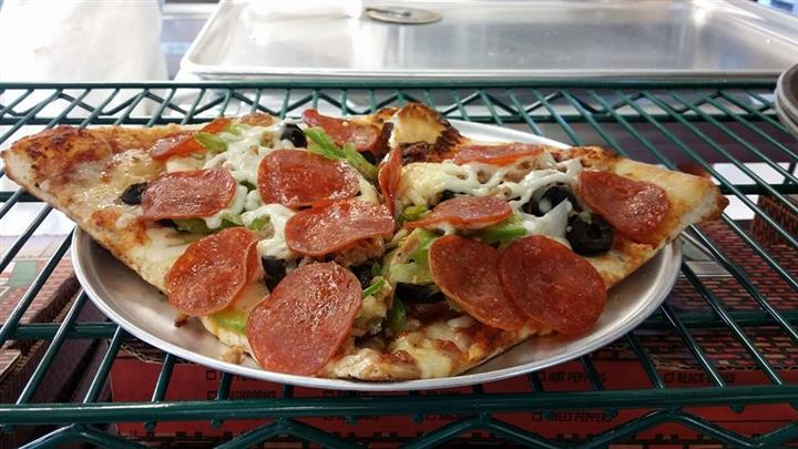 pizza with olives, green peppers and pepperoni