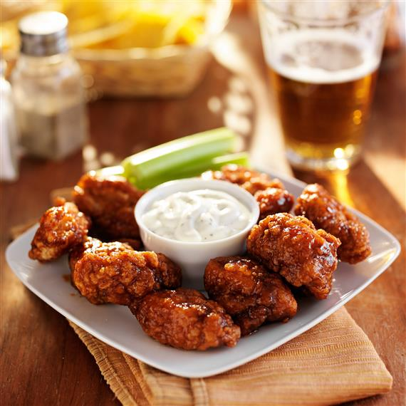 wings on a plate with celery and dipping sauce