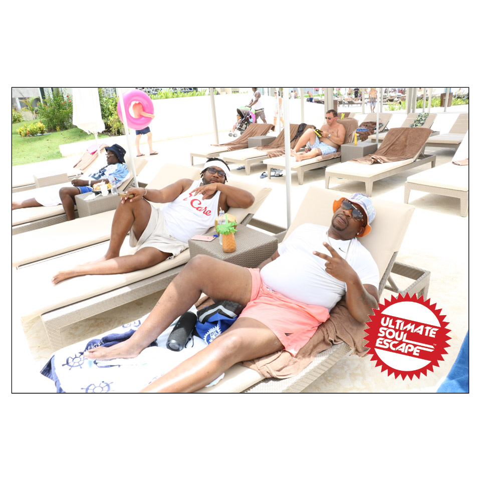 two guys laying on lounge chairs