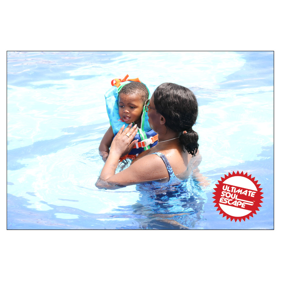 a lady and a baby swimming in the pool