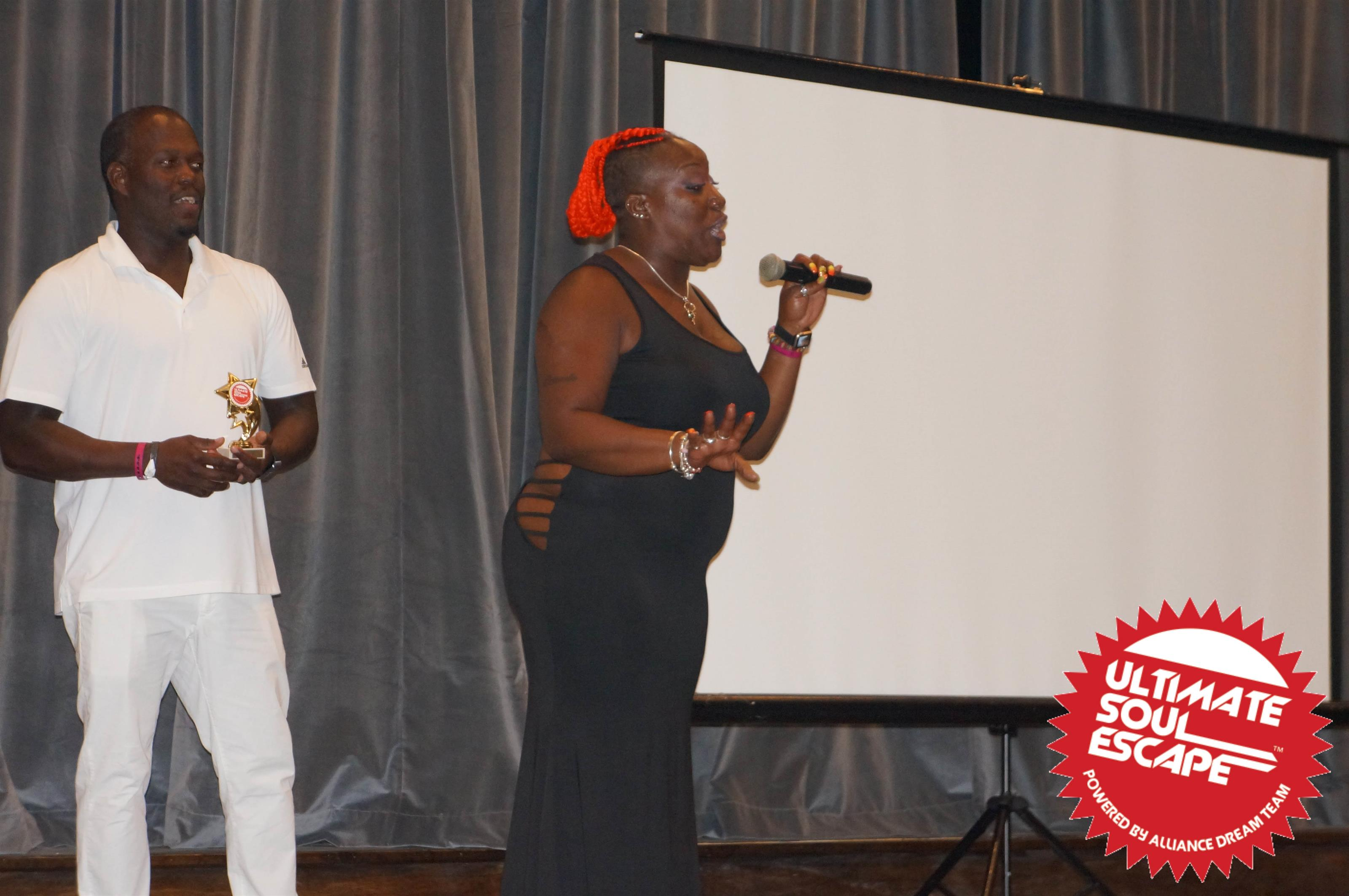 a man giving out an award and a lady giving a speech