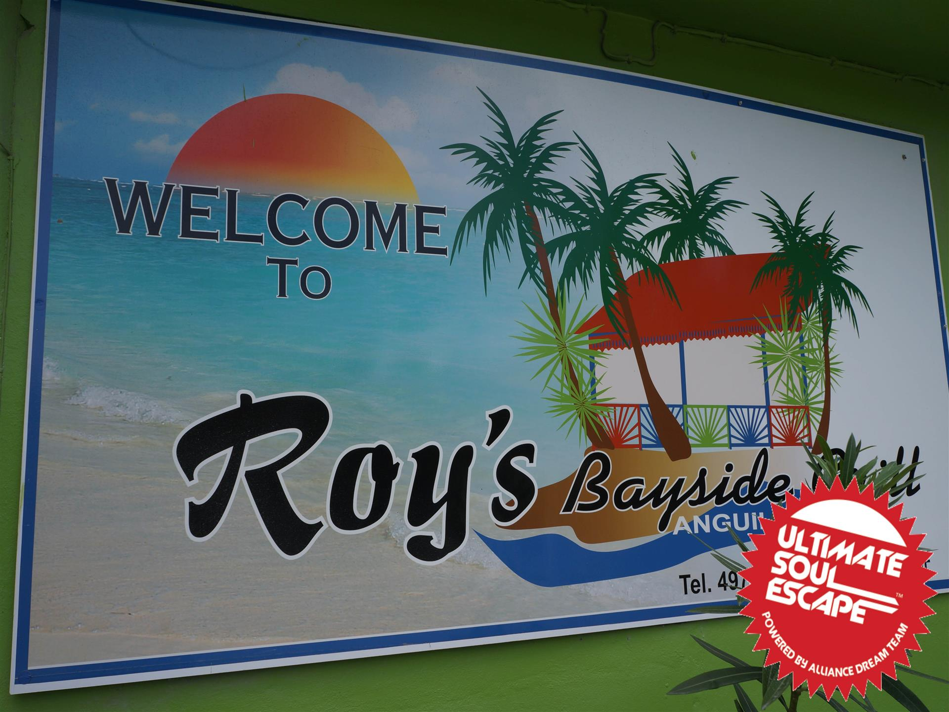 welcome to roy's bayside sign