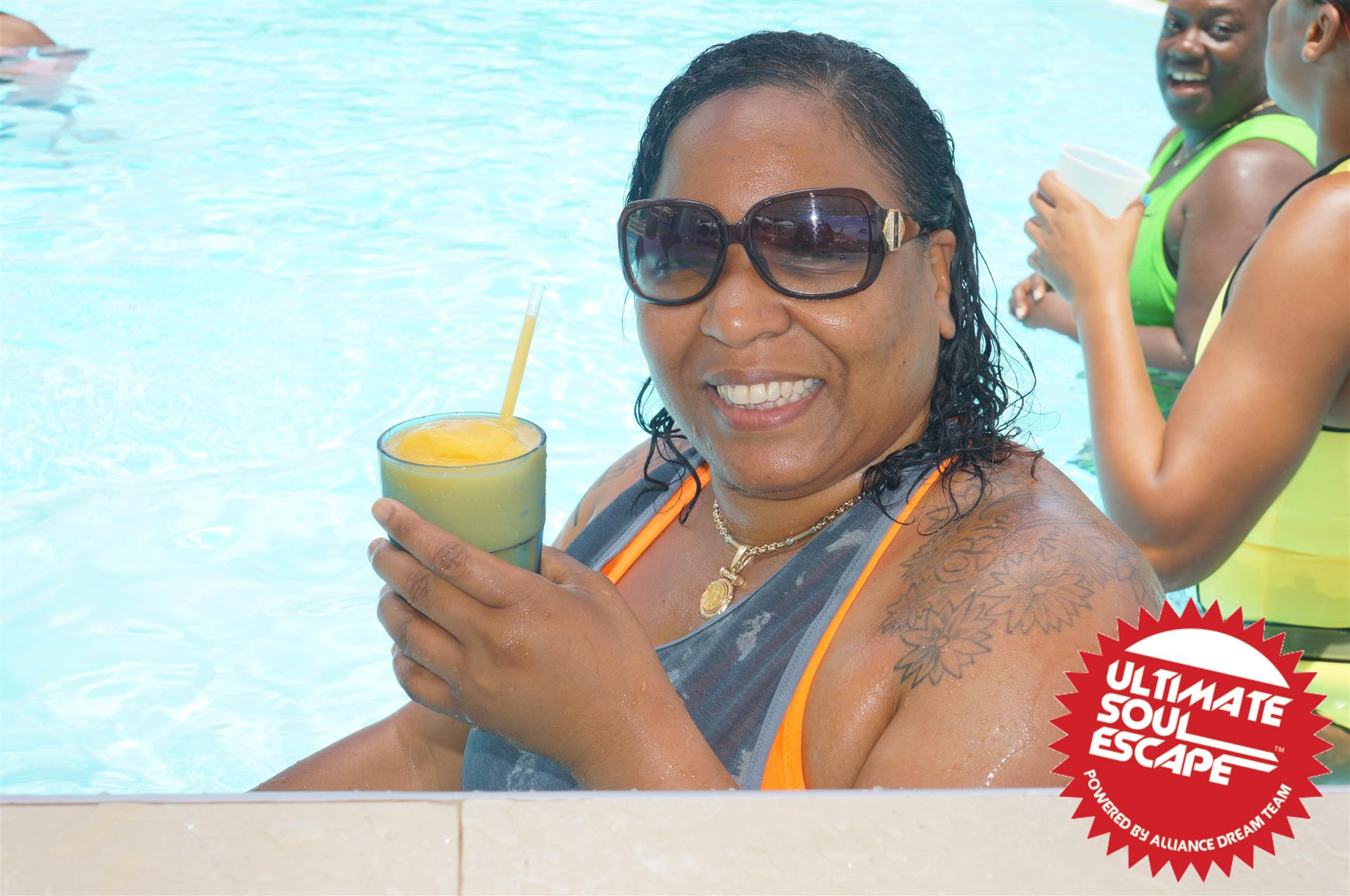 A women holding a slushie in a pool