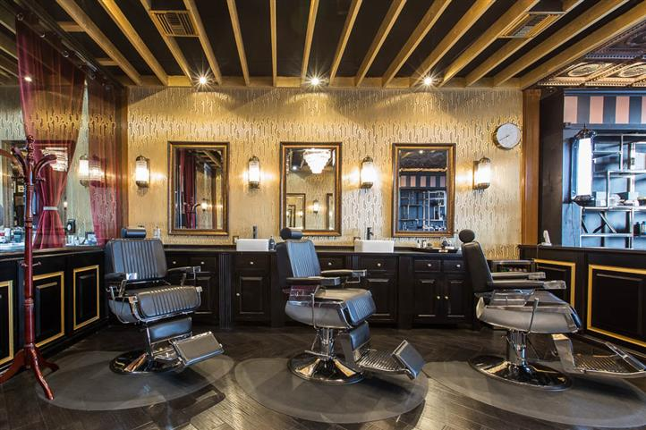 three barber stations with empty chairs