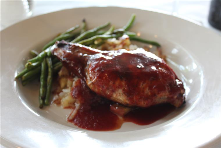 Turkey & Dressing. Turkey breast roasted fresh daily over herb stuffing topped with gravy. Served with mashed potatoes and garlic green beans with fruit chutney garnish