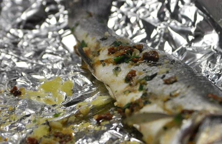 a fish baked in tin foil with spices