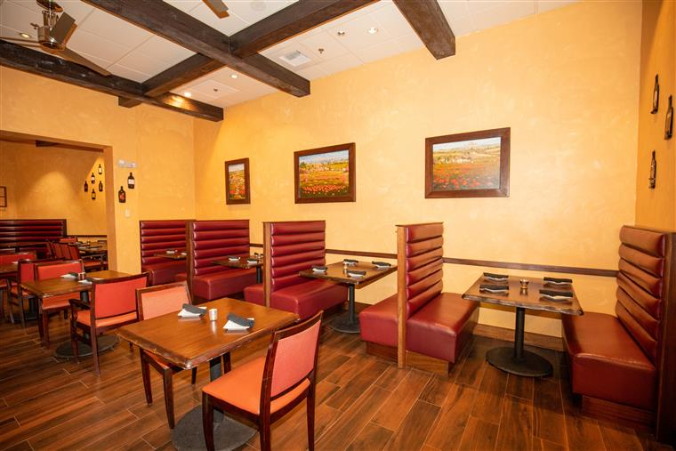 Dining area with tables and booths inside Trattoria Toscana Italian Restaurant
