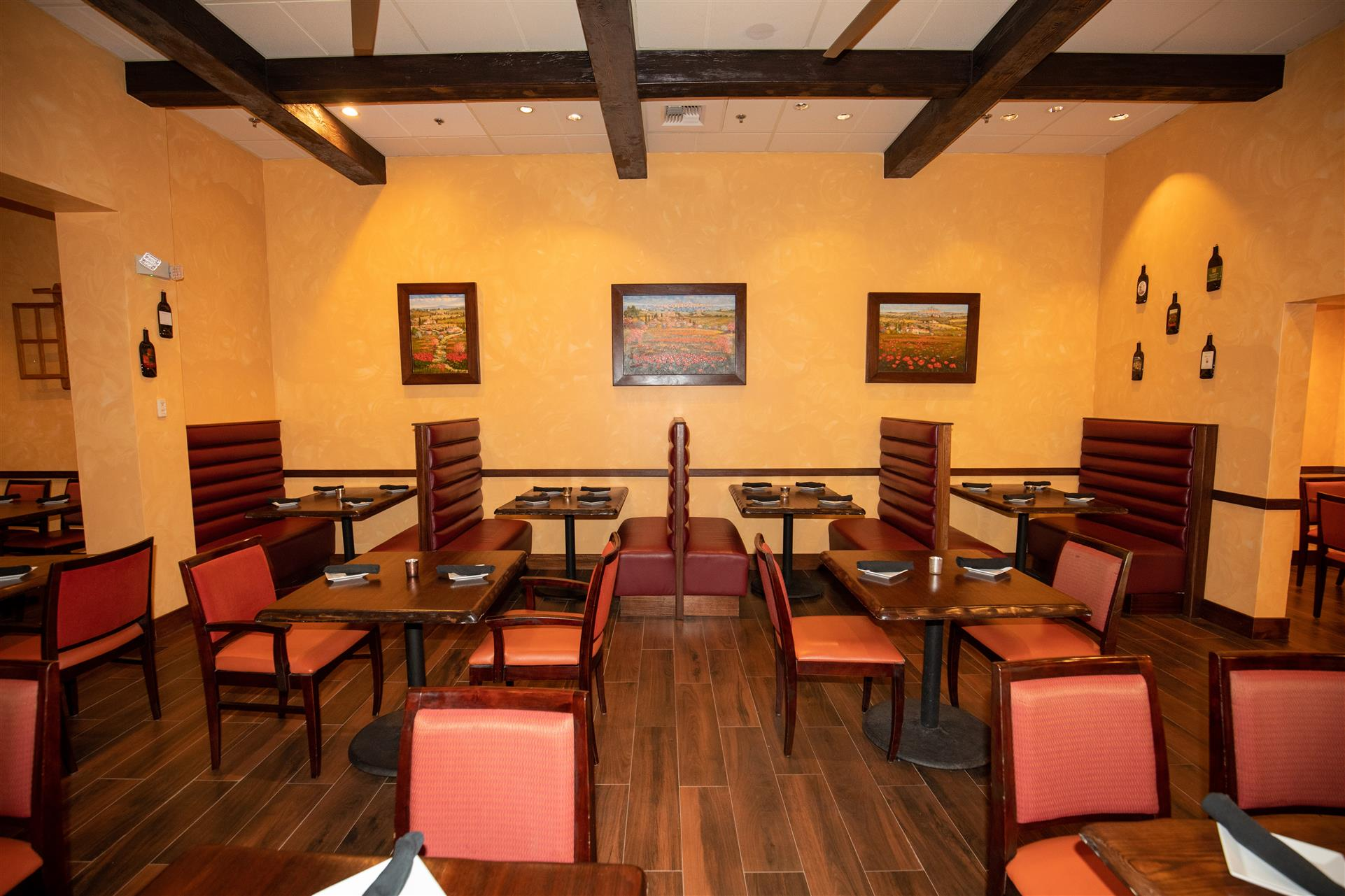 dining area with booths and tables