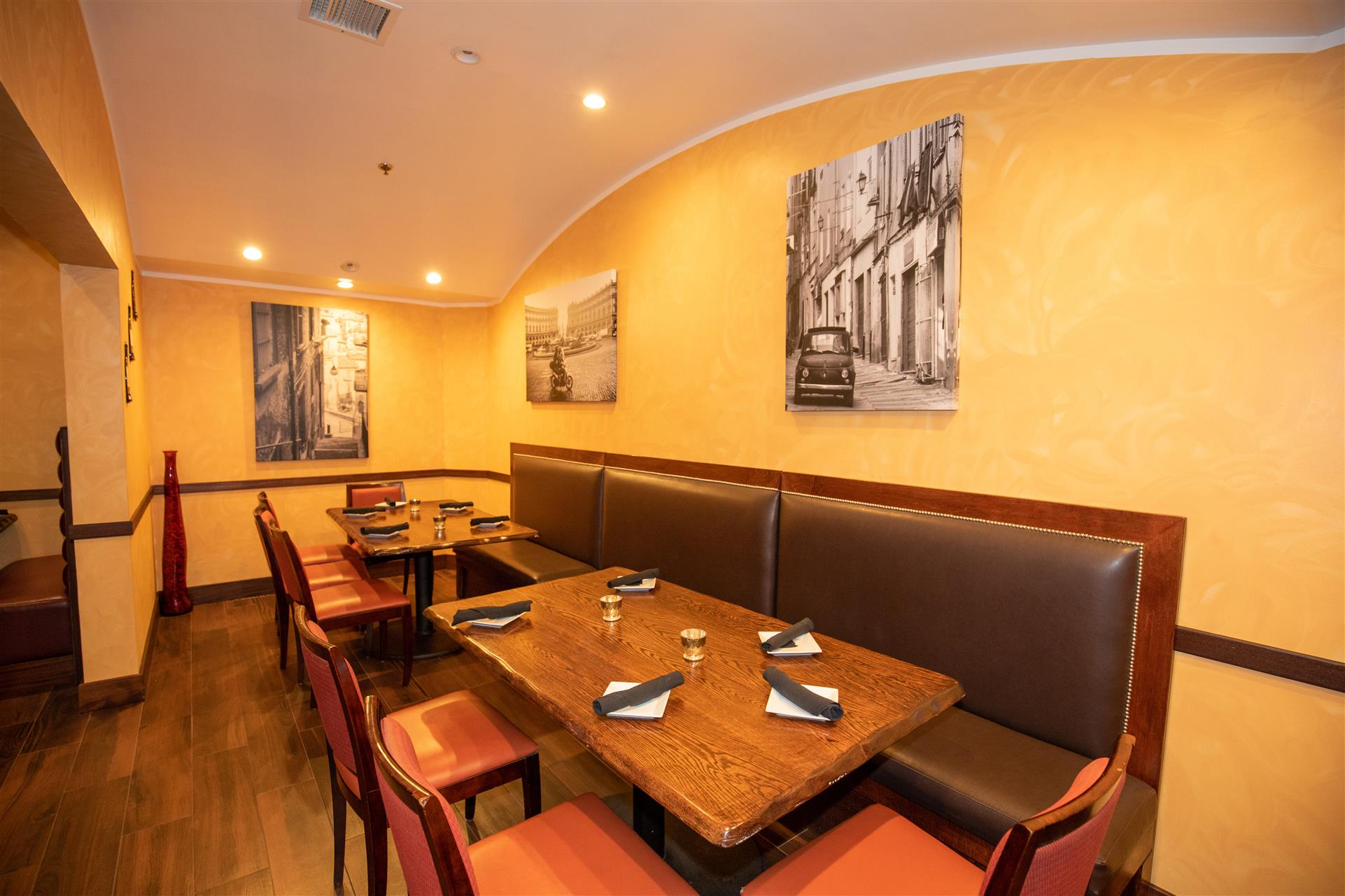 Privacy Room area inside the restaurant with paintings on the wall and tables and chairs