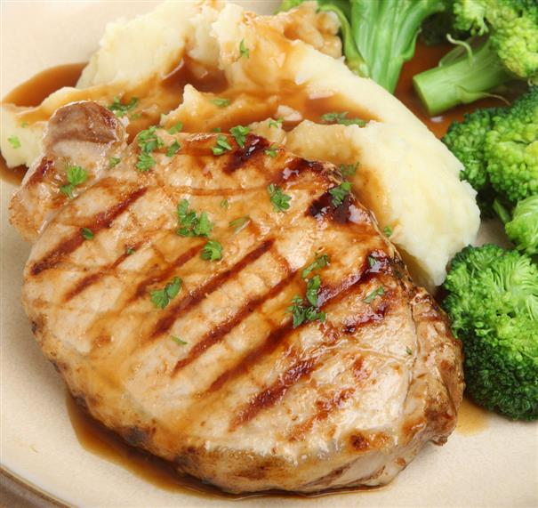 grilled pork chop with mashed potatoes and broccoli