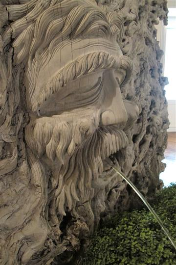 sculpture of man with water coming out of his mouth