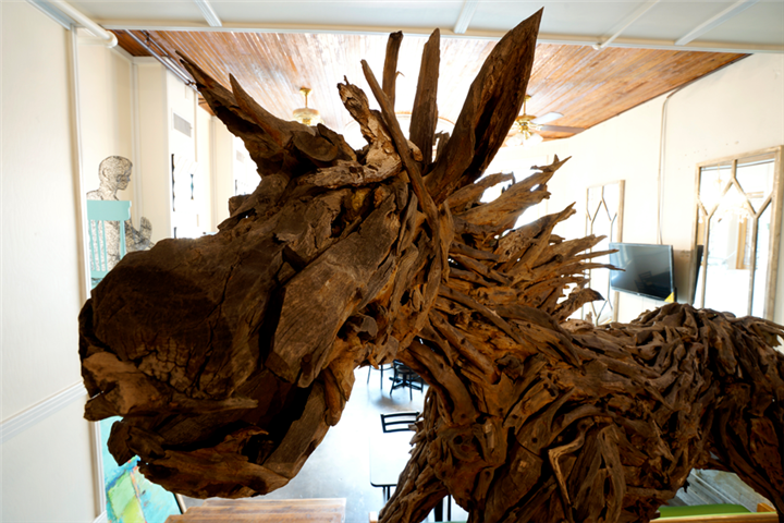 Wood sculpture of equine-looking animal