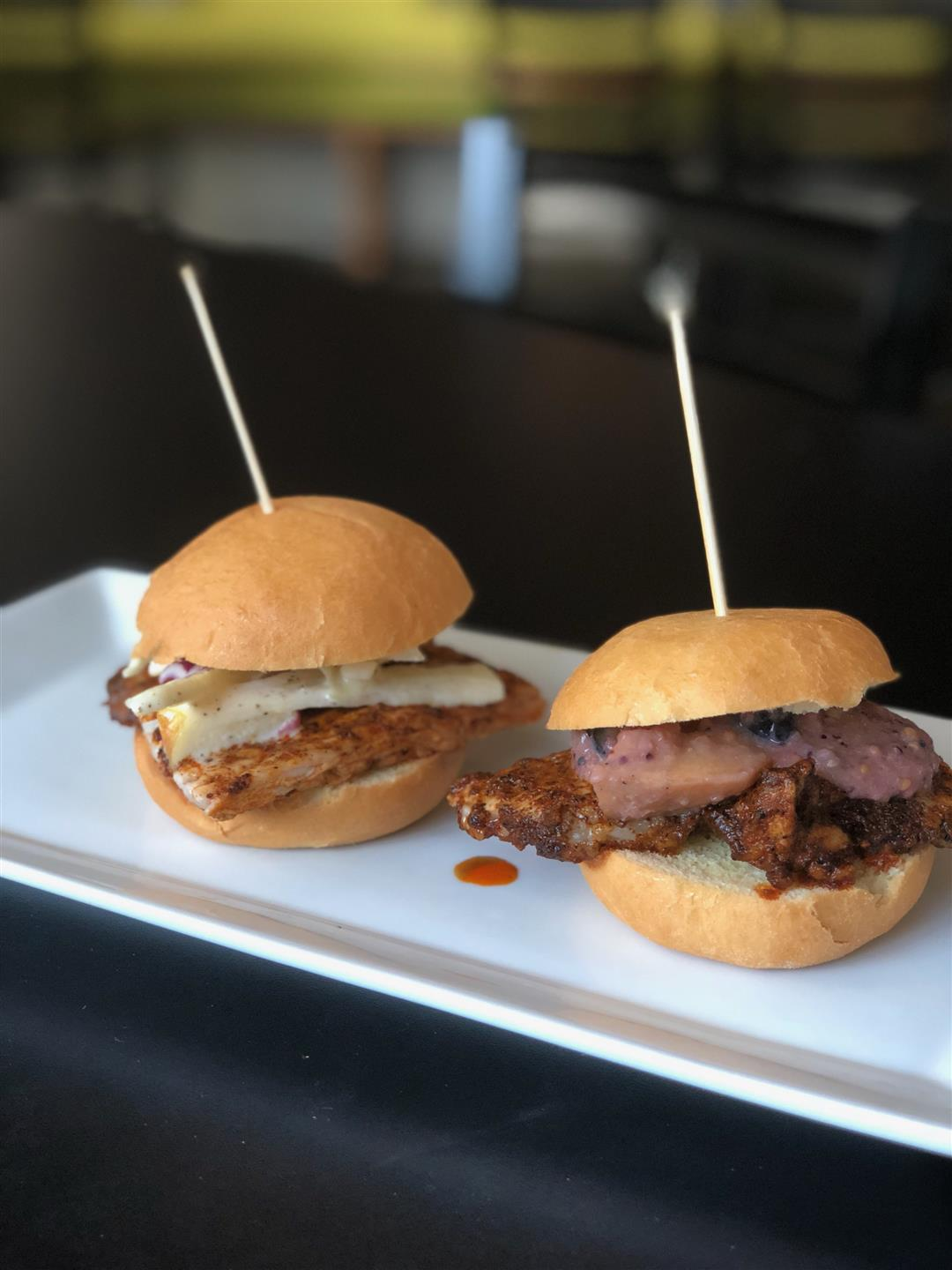 two sliders with toothpicks in the top bun