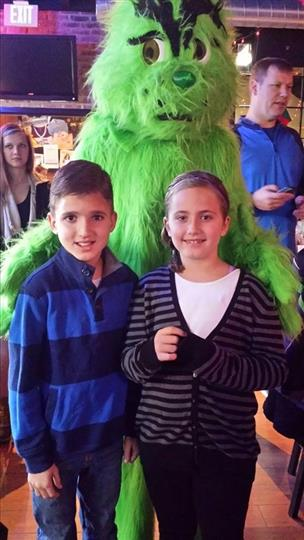 young boy and girl with the grinch