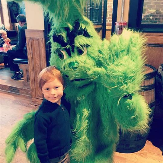 young boy with the grinch