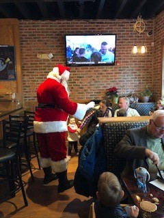 santa claus greeting customers