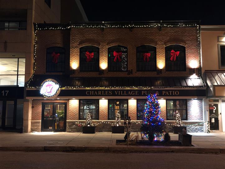 front view of restaurant at night decorated for christmas