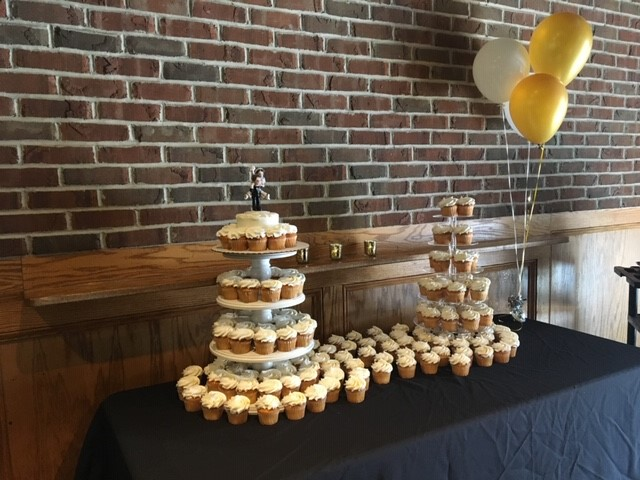 cupcakes stacked on a clothed table