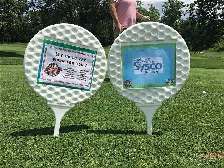 signs on big plastic golf balls