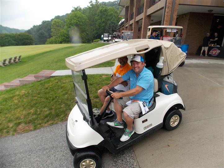 men riding in golf cart