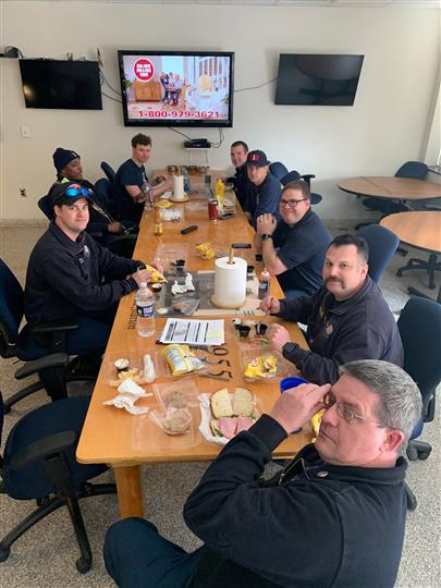 firefighters sitting at table