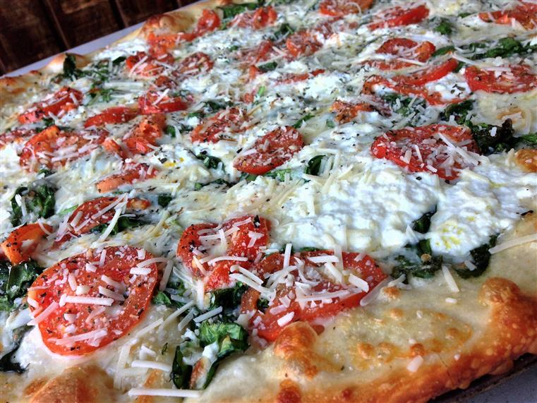 Pizza with tomato spinach and cheese
