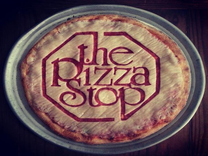 A pizza crust with the pizza stop carved into it