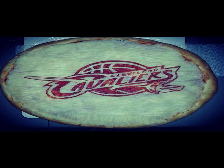A pizza crust with clevelend cavaliers carved into it