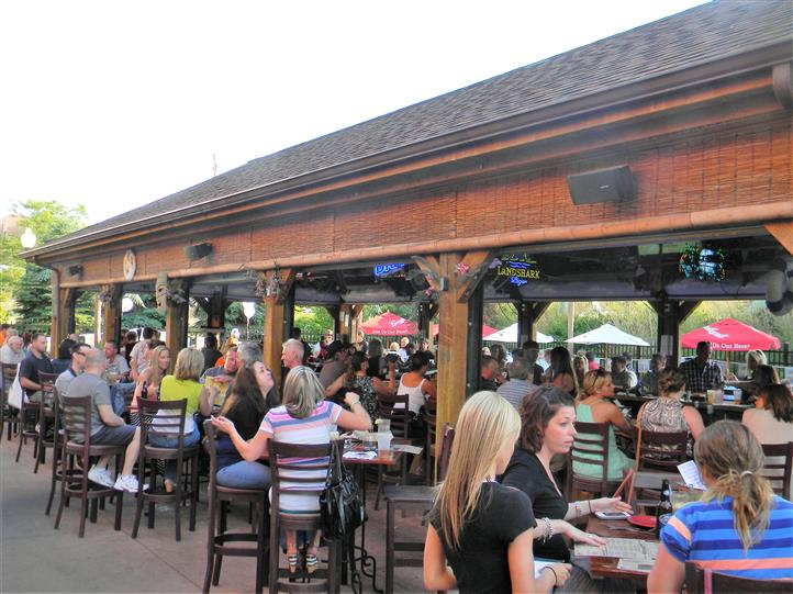 customers sitting at tables on the patio