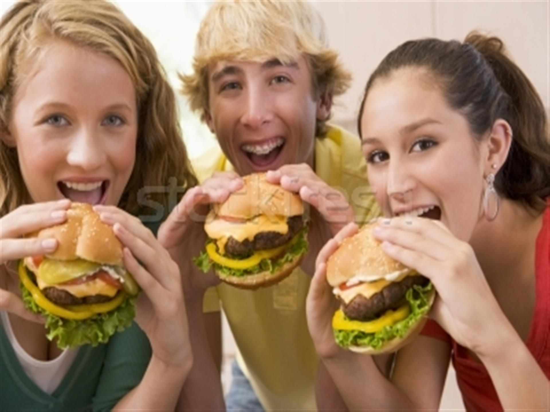 Teenagers enjoying hamburgers