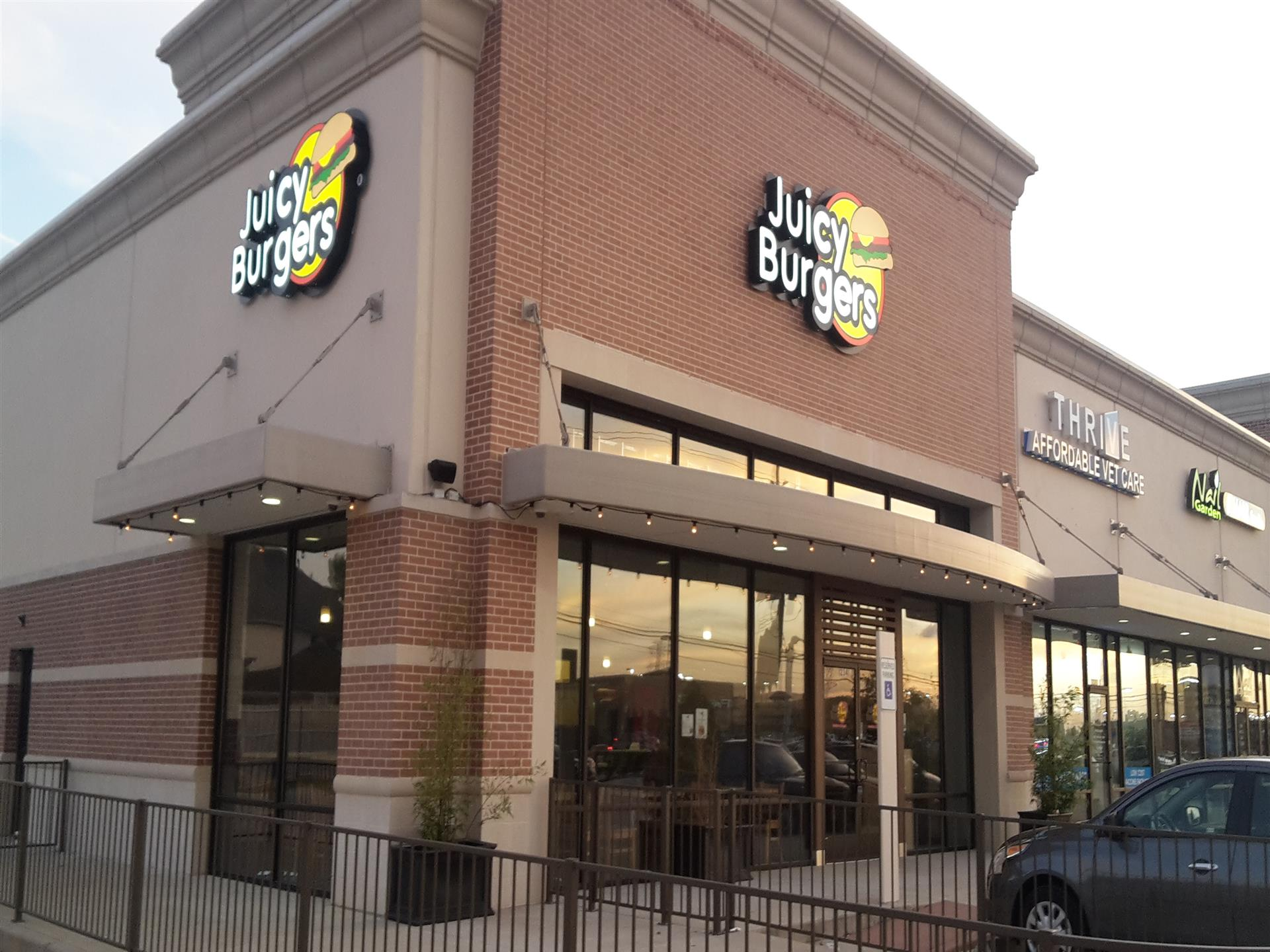 Juicy Burgers Exterior showing front entrance and adjacent stores