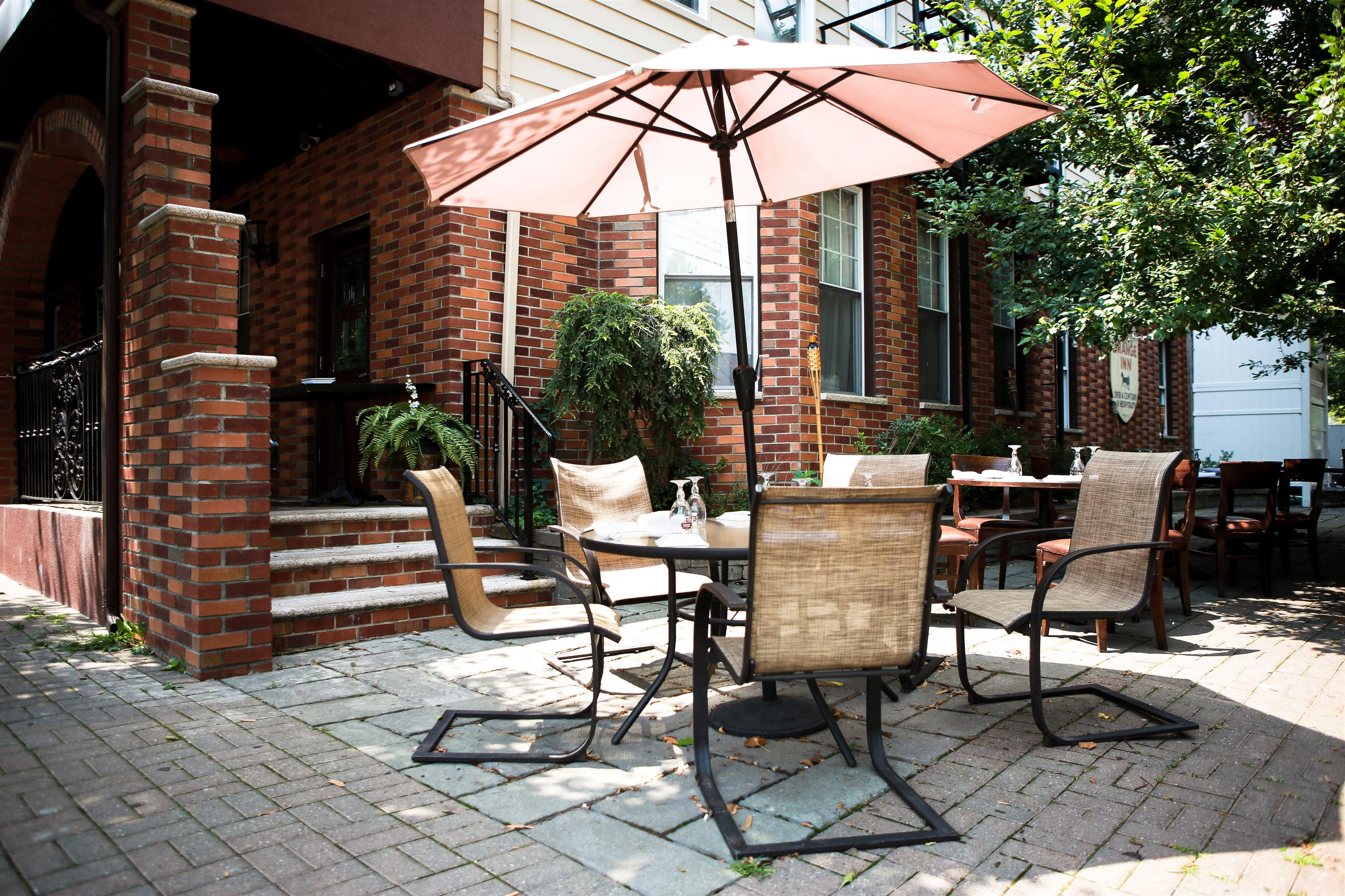 outdoor table with four seats and an umbrella