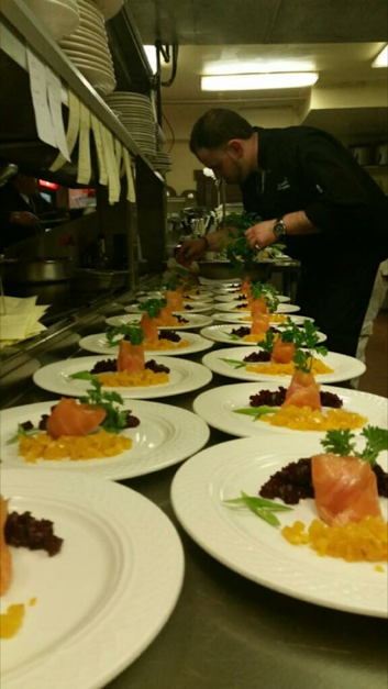 many plates of a tuna dish for catering