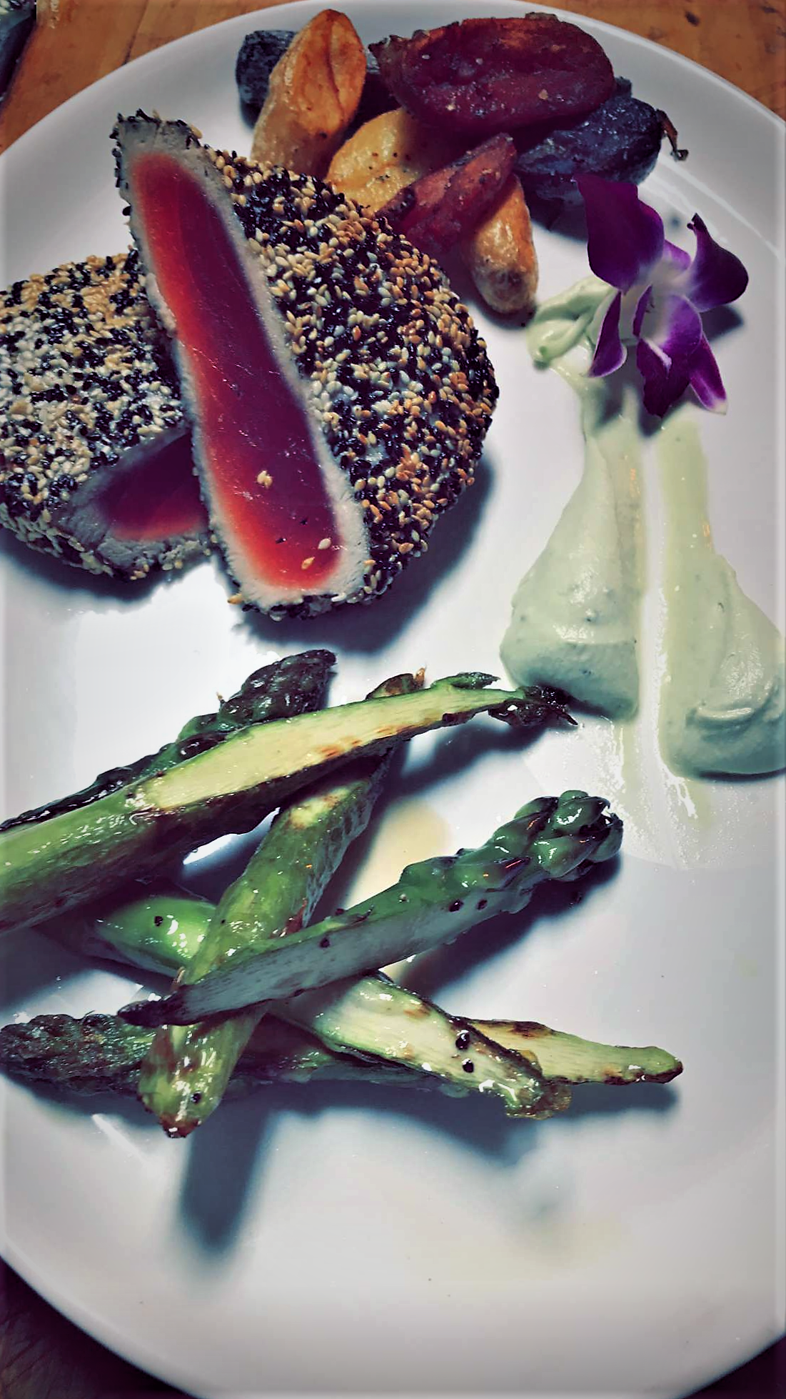 a plate with two pieces of tuna and a side of asparagus