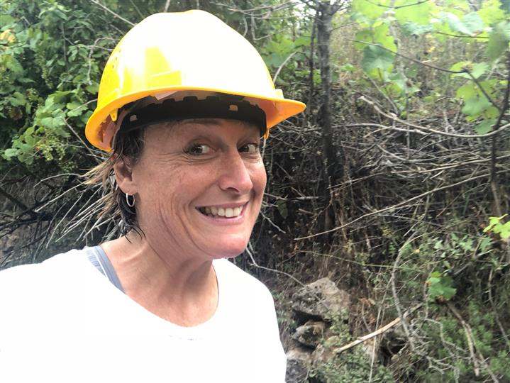 Selfie of woman smiling with hard hat on