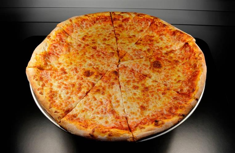 plain round pizza cut into 8 slices on serving dish