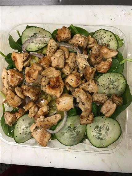 Chicken and cucumbers in clear container