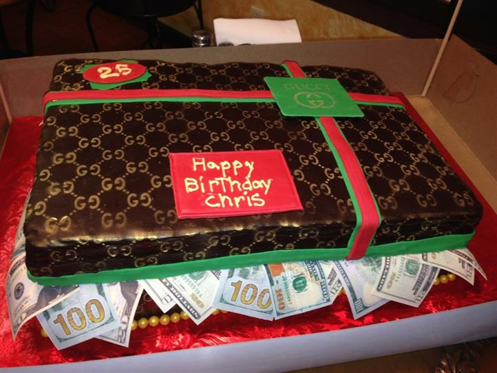 happy birthday cake with a gucci bag full of 100 dollar bills