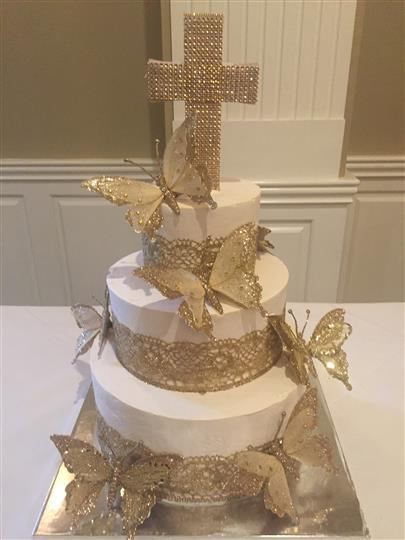 cake topped with a cross