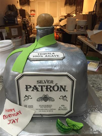cake shaped like bottle of tequila