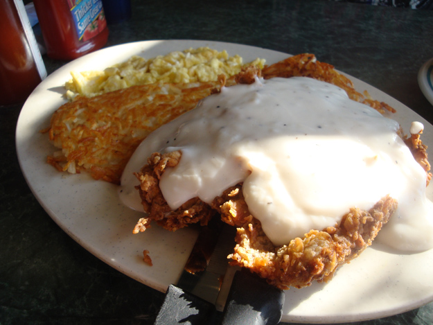 chicken fried steak with eggs, hashbrowns and gravy.