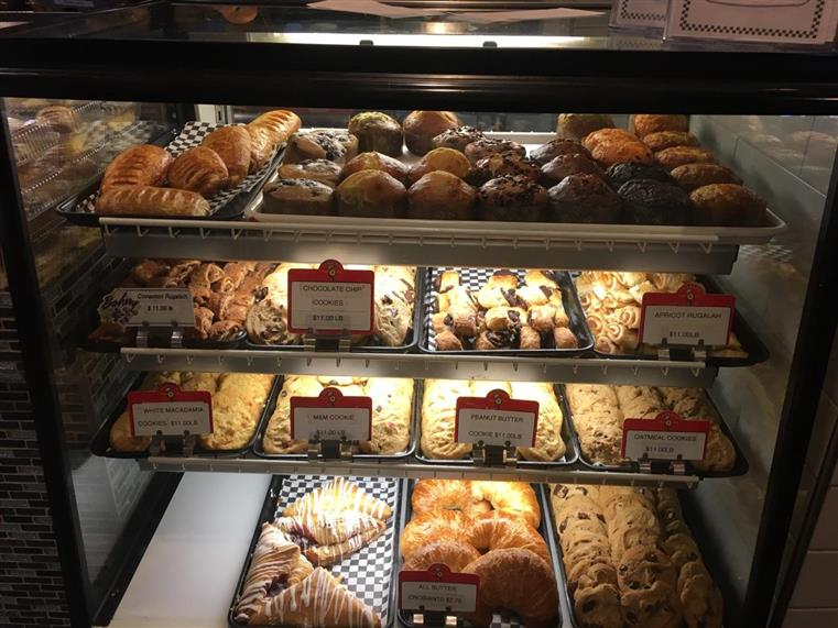 Glass display showing several different pastries