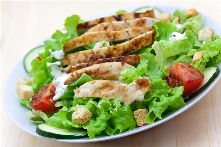 Salad with croutons, tomatoes, cucumbers, and grilled chicken