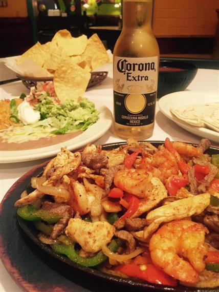 fajita with a bottle of corona extra