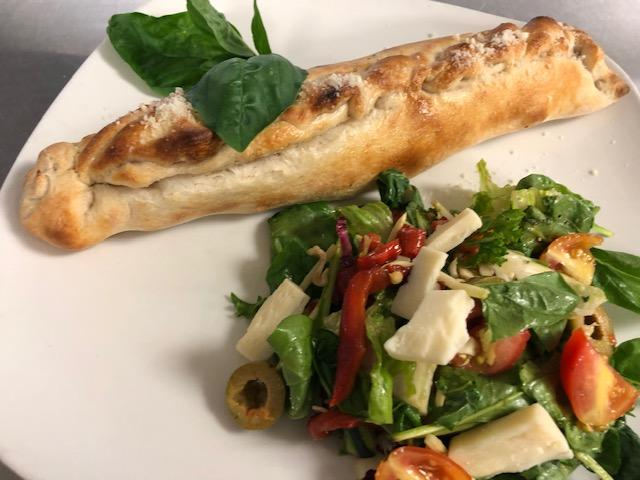 Stromboli with an italian chopped salad