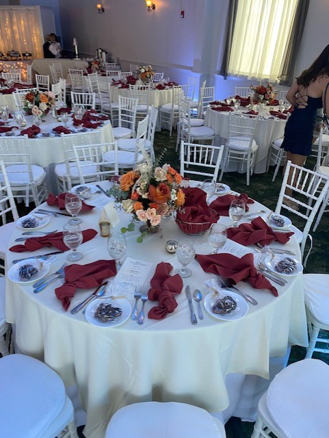 table set up for guests with flower center piece